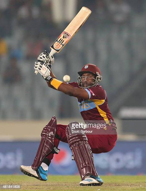 Dwayne Bravo of the West Indies falls over as he bats during the ICC World Twenty20 Bangladesh 2014 match between West Indies and Pakistan at...