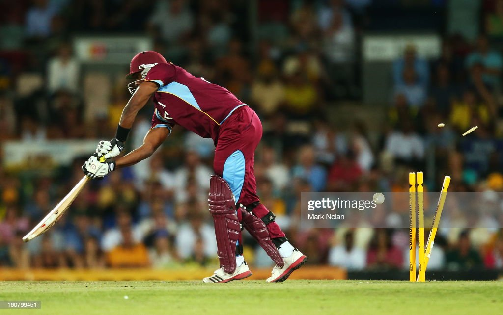 <a gi-track='captionPersonalityLinkClicked' href=/galleries/search?phrase=Dwayne+Bravo&family=editorial&specificpeople=178945 ng-click='$event.stopPropagation()'>Dwayne Bravo</a> of the West Indies is bowled by Mitchell Starc during the Commonwealth Bank One Day International Series between Australia and the West Indies at Manuka Oval on February 6, 2013 in Canberra, Australia.