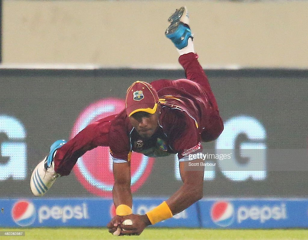 <a gi-track='captionPersonalityLinkClicked' href=/galleries/search?phrase=Dwayne+Bravo&family=editorial&specificpeople=178945 ng-click='$event.stopPropagation()'>Dwayne Bravo</a> of the West Indies takes a diving catch in the outfield to dismiss Angelo Mathews of Sri Lanka during the ICC World Twenty20 Bangladesh 2014 1st Semi-Final match between Sri Lanka and the West Indies at Sher-e-Bangla Mirpur Stadium on April 3, 2014 in Dhaka, Bangladesh.