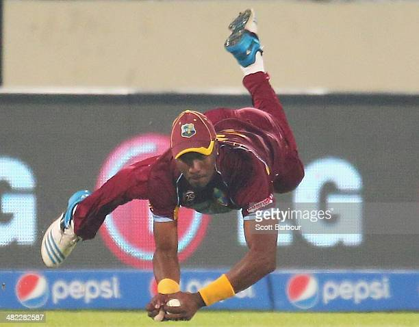 Dwayne Bravo of the West Indies takes a diving catch in the outfield to dismiss Angelo Mathews of Sri Lanka during the ICC World Twenty20 Bangladesh...