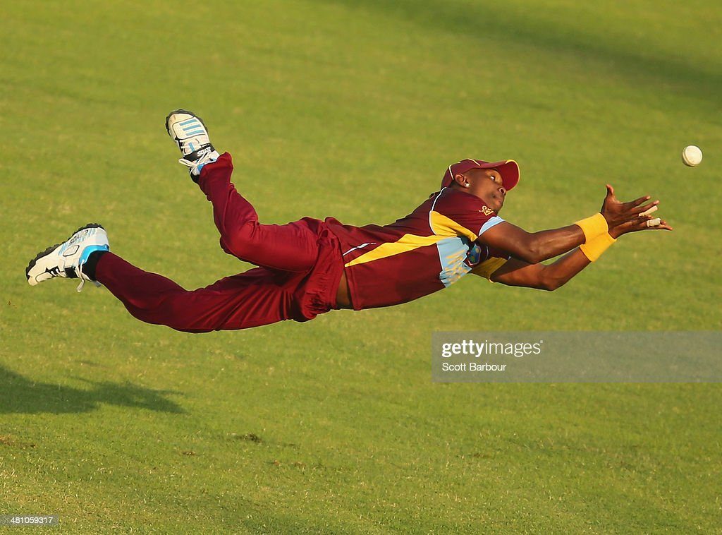 <a gi-track='captionPersonalityLinkClicked' href=/galleries/search?phrase=Dwayne+Bravo&family=editorial&specificpeople=178945 ng-click='$event.stopPropagation()'>Dwayne Bravo</a> the West Indies takes a diving catch in the outfield to dismiss James Faulkner of Australia during the ICC World Twenty20 Bangladesh 2014 match between Australia and the West Indies at Sher-e-Bangla Mirpur Stadium on March 28, 2014 in Dhaka, Bangladesh.