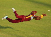 Dwayne Bravo the West Indies takes a diving catch in the outfield to dismiss James Faulkner of Australia during the ICC World Twenty20 Bangladesh...