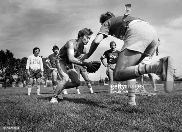 Dwayne Bridges of A_rvada and Paul Howell of Denver square off in a flag drill on a baseball field in Englewood while other members of the Marauders...