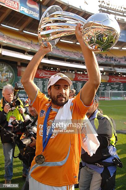 Dwayne De Rosario of the Houston Dynamo celebrates with the trophy after defeating the New England Revolution by a score of 21 to win the 2007 Major...