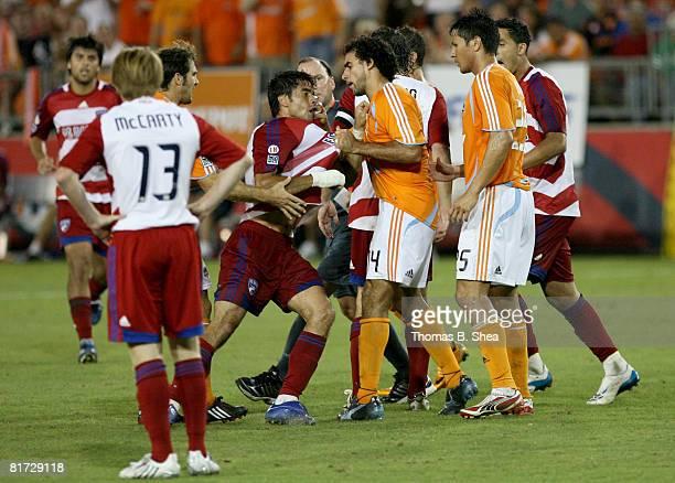Dwayne De Rosario of the Houston Dynamo pulls up Marcelo Saragosa of FC Dallas by his shirt at Robertson Stadium June 26 2008 in Houston Texas