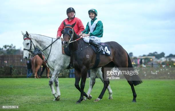 Dwayne Dunn returns to the mounting yard on Thaad after winning Bay and Ranges Region Handicapat Flemington Racecourse on June 24 2017 in Flemington...