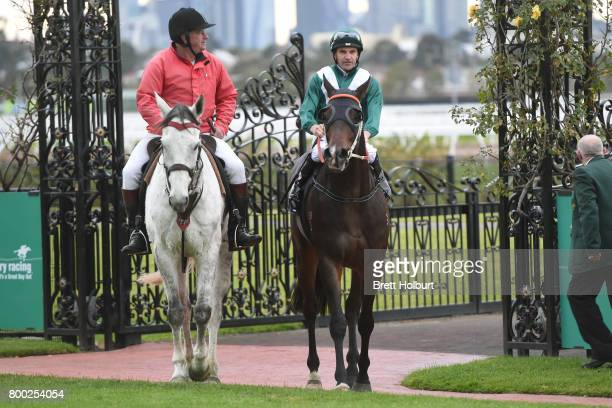 Dwayne Dunn returns to the mounting yard on Thaad after winning Bay and Ranges Region Handicap at Flemington Racecourse on June 24 2017 in Flemington...