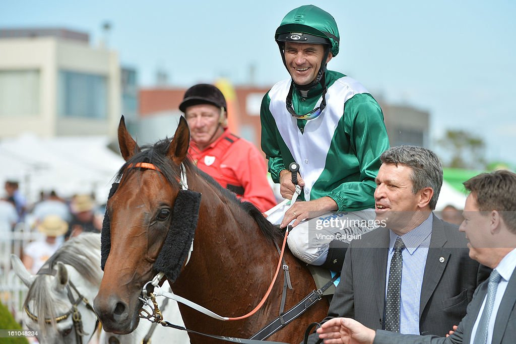 Dwayne Dunn riding All To Hard is led in by Syndicate manager Peter Orton after winning the Sportingbet C.F.Orr Stakes during Melbourne Racing at Caulfield Racecourse on February 9, 2013 in Melbourne, Australia.