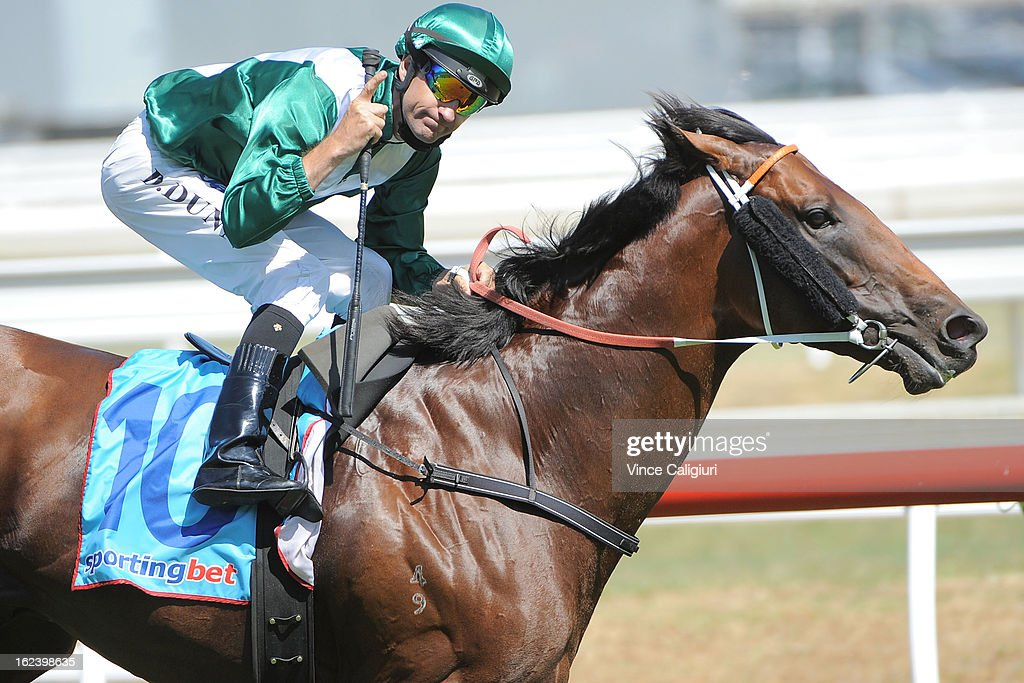 Dwayne Dunn riding All To Hard wins the Cathay Pacific Futurity Stakes during Melbourne racing at Caulfield Racecourse on February 23 2013 in...