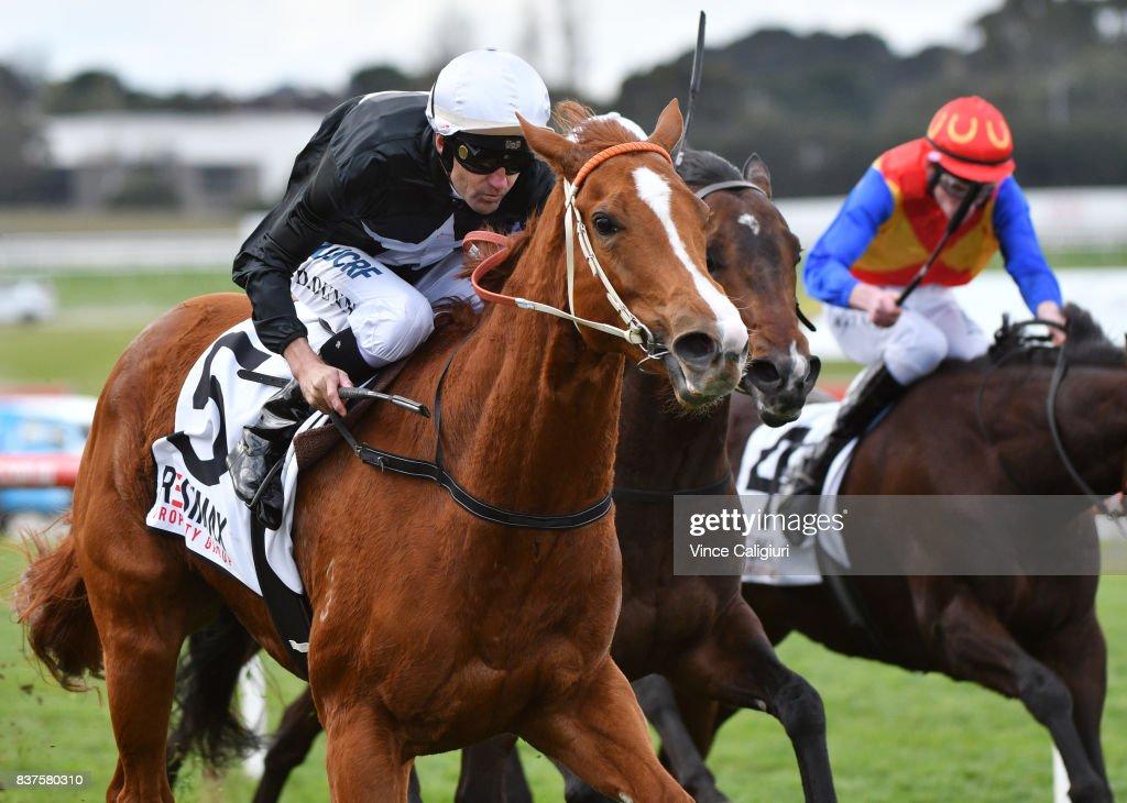 Dwayne Dunn riding Aramoana wins Race 3 during Melbourne Racing at Sandown Hillsideon August 23, 2017 in Melbourne, Australia.