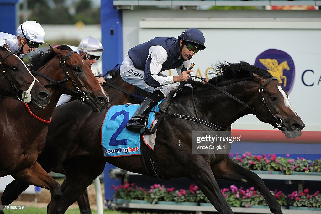 Dwayne Dunn riding Jet Away wins the Le Pine Funerals Easter Cup during Melbourne Racing at Caulfield Racecourse on March 30, 2013 in Melbourne, Australia.