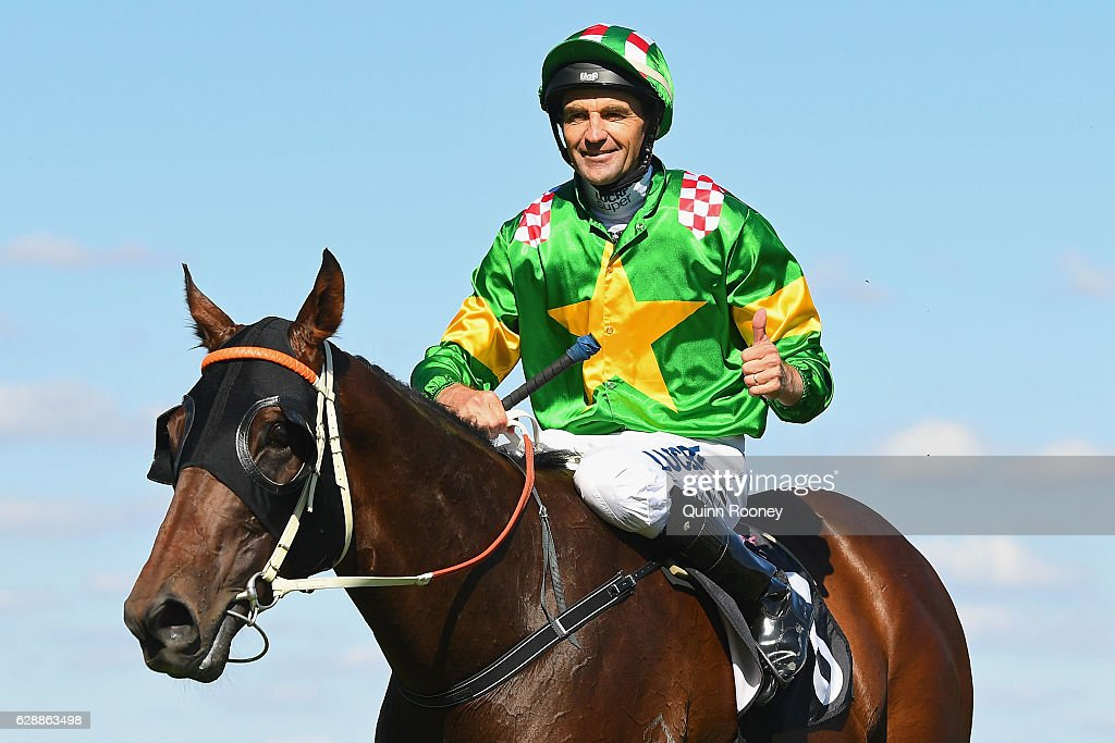 Dwayne Dunn riding Snoopy returns to scale after winning Race 7 the Western Health First Response Pharmacy Cup during Melbourne Racing at Flemington Racecourse on December 10, 2016 in Melbourne, Australia.