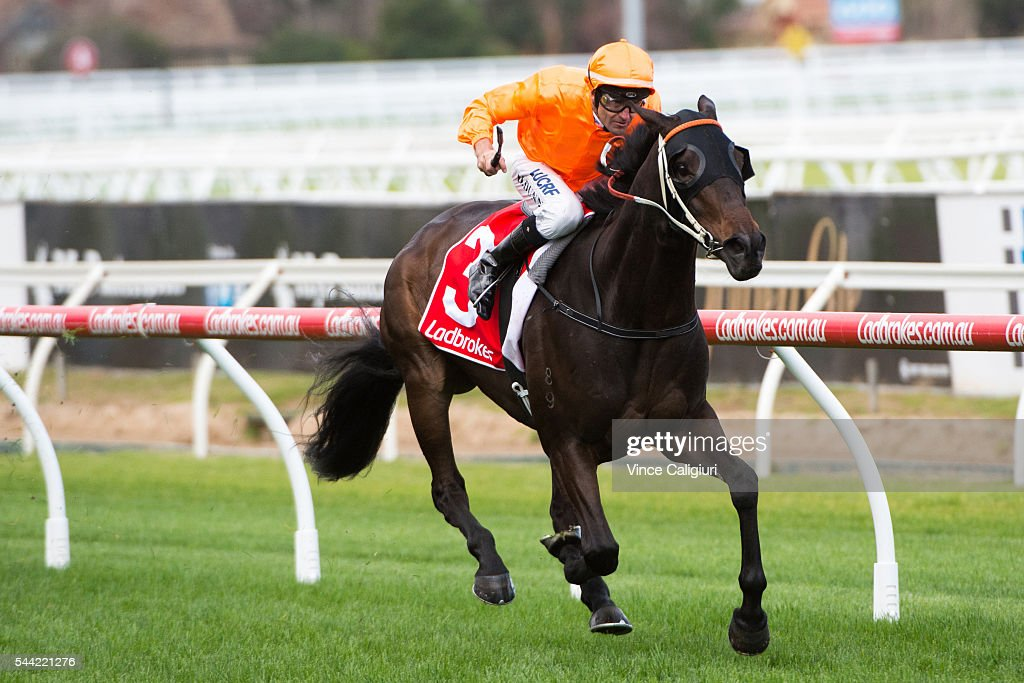 Dwayne Dynn riding Longeron wins Race 2, during Melbourne Racing at Caulfield Racecourse on July 2, 2016 in Melbourne, Australia.