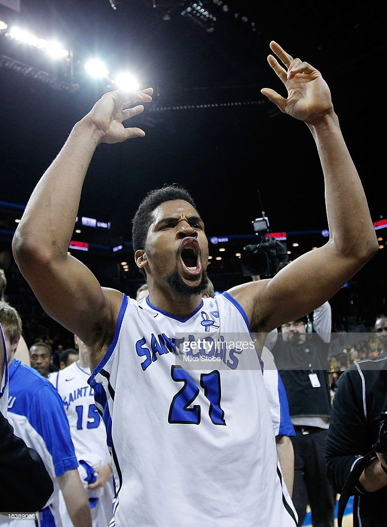 Dwayne Evans #21 of the Saint Louis Billikens celebrates after winning the A10 championship against Virginia Commonwealth Rams walks off the court during the Atlantic 10 Basketball Tournament - Championship Game at Barclays Center on March 17, 2013 in the Brooklyn borough of New York City. Saint Louis Billikens defeated Virginia Commonwealth Rams 62-56.
