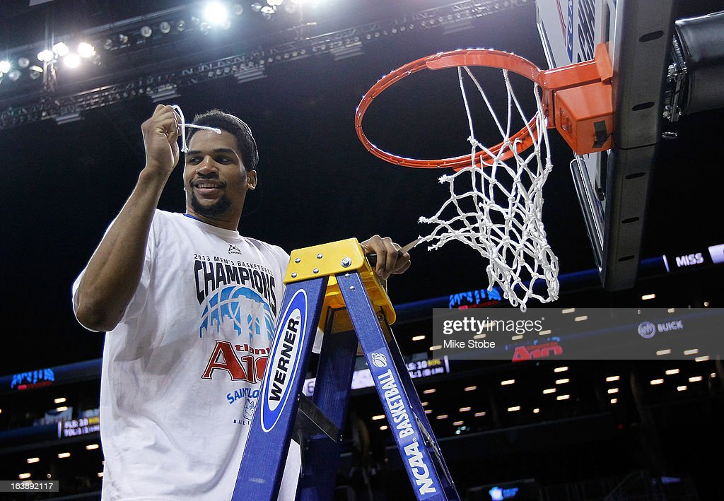 Dwayne Evans #21 of the Saint Louis Billikens cuts down the net after winning the A10 championship against Virginia Commonwealth Rams during the Atlantic 10 Basketball Tournament - Championship Game at Barclays Center on March 17, 2013 in the Brooklyn borough of New York City. Saint Louis Billikens defeated Virginia Commonwealth Rams 62-56.