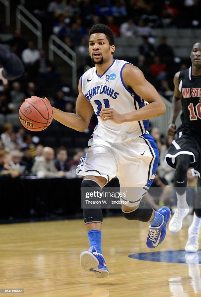 Dwayne Evans #21 of the Saint Louis Billikens dribbles the ball up court against the New Mexico State Aggies in the first half during the second round of the 2013 NCAA Men's Basketball Tournament at HP Pavilion on March 21, 2013 in San Jose, California.