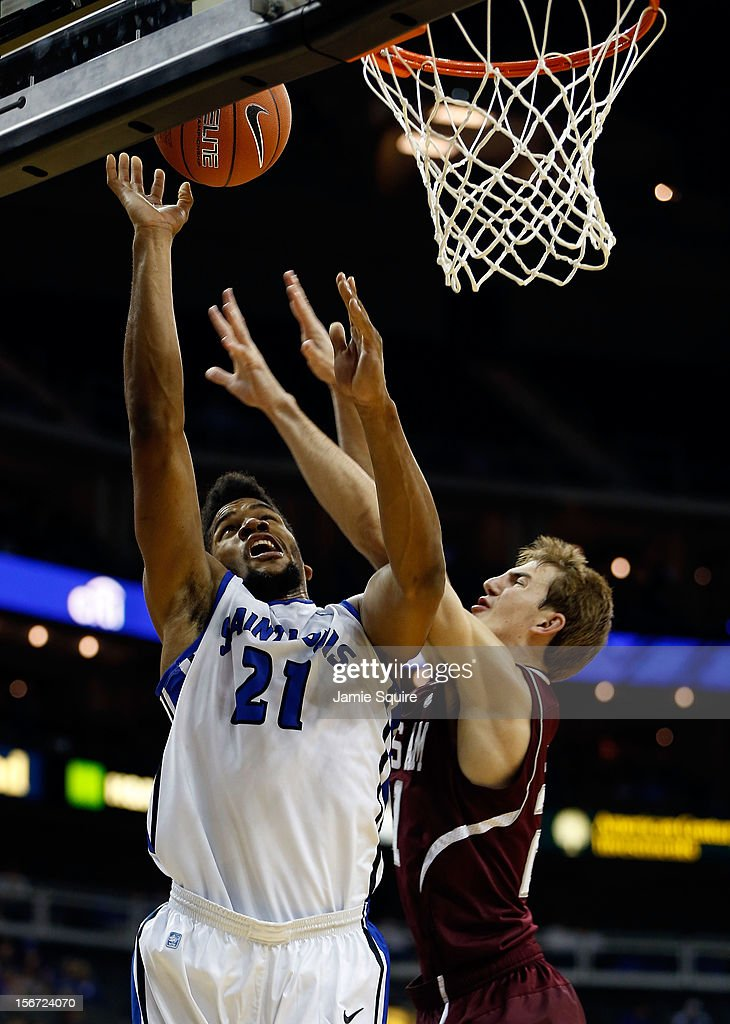 Dwayne Evans #21 of the Saint Louis Billikens shoots over Alex Caruso #21 of the Texas A&M Aggies during the CBE Hall of Fame Classic at Sprint Center on November 19, 2012 in Kansas City, Missouri.
