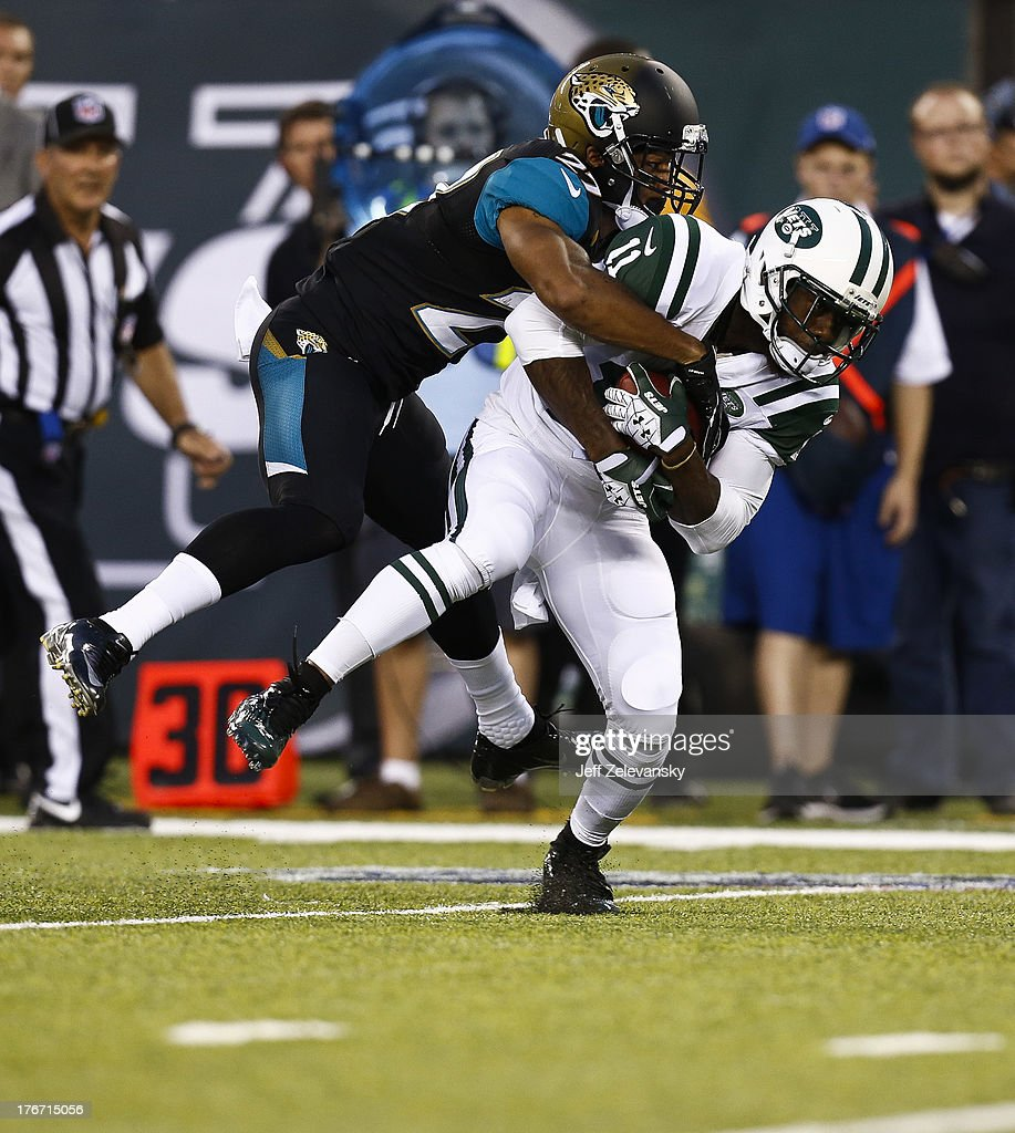 Dwayne Gratz #27 of the Jacksonville Jaguars takes down <a gi-track='captionPersonalityLinkClicked' href=/galleries/search?phrase=Jeremy+Kerley&family=editorial&specificpeople=4779050 ng-click='$event.stopPropagation()'>Jeremy Kerley</a> #11 of the New York Jets during their preseason game at MetLife Stadium on August 17, 2013 in East Rutherford, New Jersey.