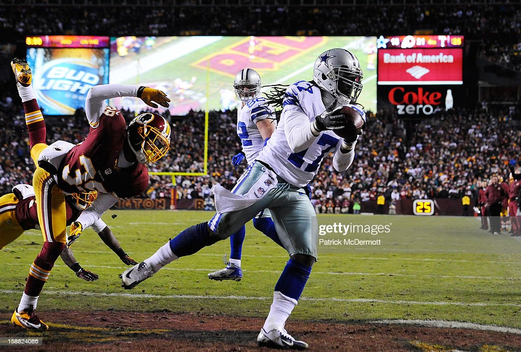 Dwayne Harris #17 of the Dallas Cowboys catches a pass for a two-point conversion in the fourth quarter against the Washington Redskins at FedExField on December 30, 2012 in Landover, Maryland.