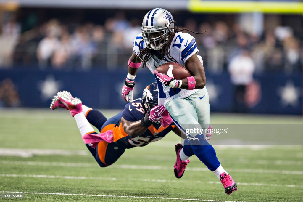 Dwayne Harris #17 of the Dallas Cowboys runs with the ball but is grabbed by <a gi-track='captionPersonalityLinkClicked' href=/galleries/search?phrase=Danny+Trevathan&family=editorial&specificpeople=6475347 ng-click='$event.stopPropagation()'>Danny Trevathan</a> #59 of the Denver Broncos at AT&T Stadium on October 6, 2013 in Arlington, Texas. The Broncos defeated the Cowboys 51-48.