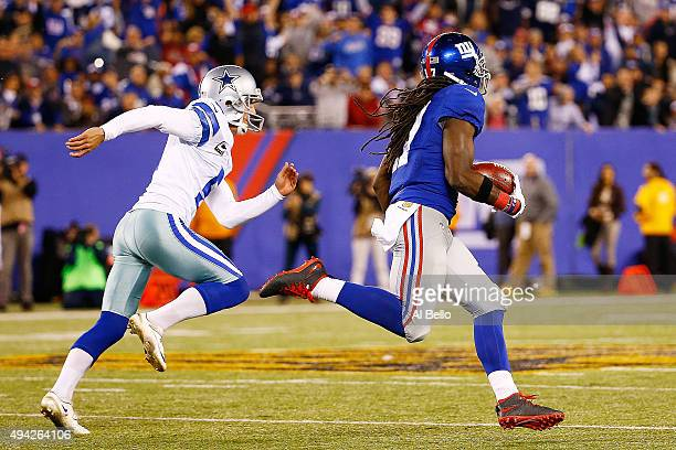Dwayne Harris of the New York Giants returns a kickoff past Dan Bailey of the Dallas Cowboys for a touchdown during the fourth quarter at MetLife...