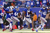 Dwayne Harris of the New York Giants returns a punt 80 yards for a touchdown in the second quarter against the New York Jets at MetLife Stadium on...