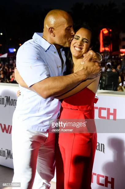 Dwayne Johnson and daughter Simone Johnson attend Paramount Pictures' World Premiere of 'Baywatch' on May 13 2017 in Miami Florida