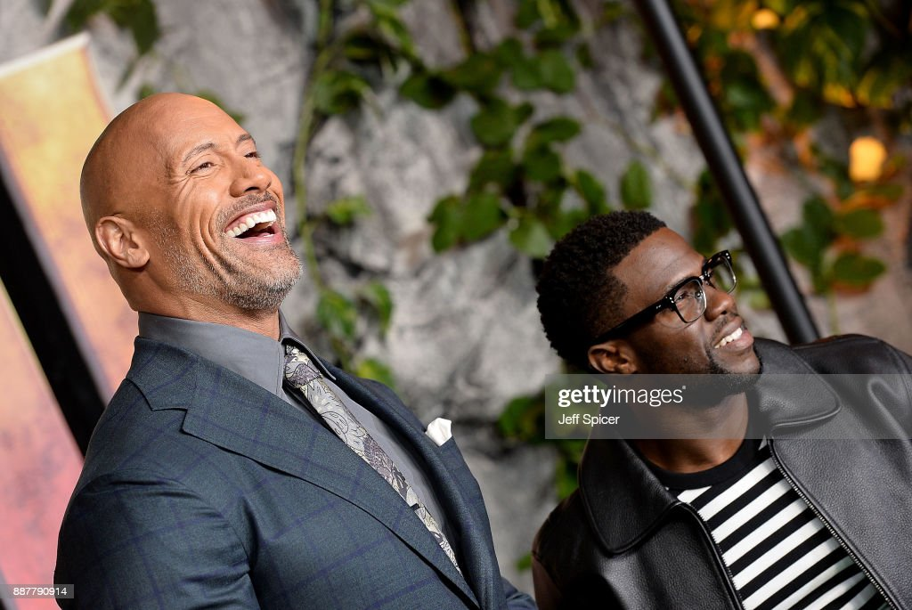 Dwayne Johnson (L) and Kevin Hart attend the 'Jumanji: Welcome To The Jungle' UK premiere held at Vue West End on December 7, 2017 in London, England.
