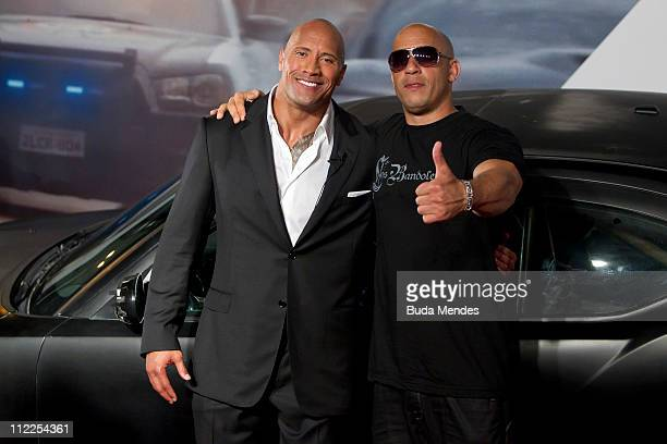 Dwayne Johnson and Vin Diesel pose for photographers during the premiere of the movie 'Fast and Furious 5' at Cinepolis Lagoon on April 15 2011 in...