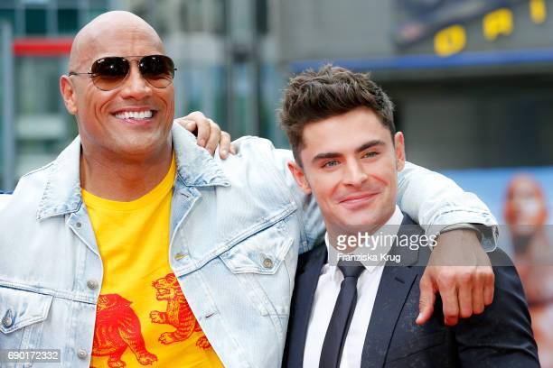 Dwayne Johnson and Zac Efron attend the 'Baywatch' Photo Call in Berlin on May 30 2017 in Berlin Germany