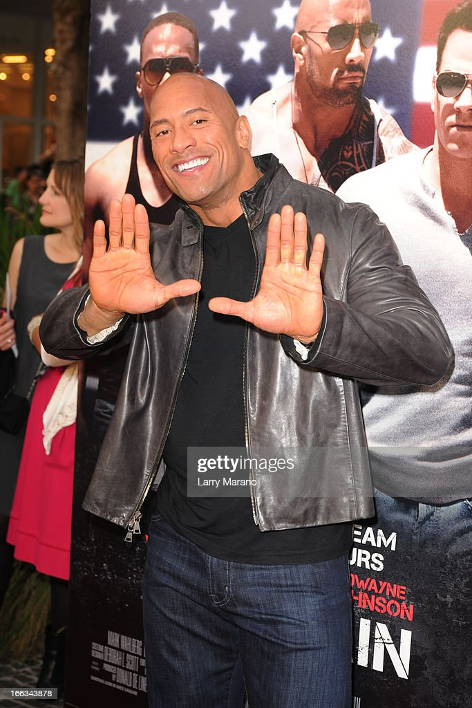 Dwayne Johnson attends the 'Pain & Gain' premiere on April 11, 2013 in Miami Beach, Florida.