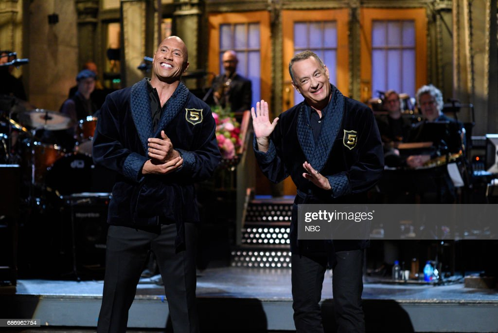 LIVE -- 'Dwayne Johnson' Episode 1725 -- Pictured: (l-r) Dwayne Johnson, Tom Hanks during 'Opening Monologue' in Studio 8H on May 20, 2017 --