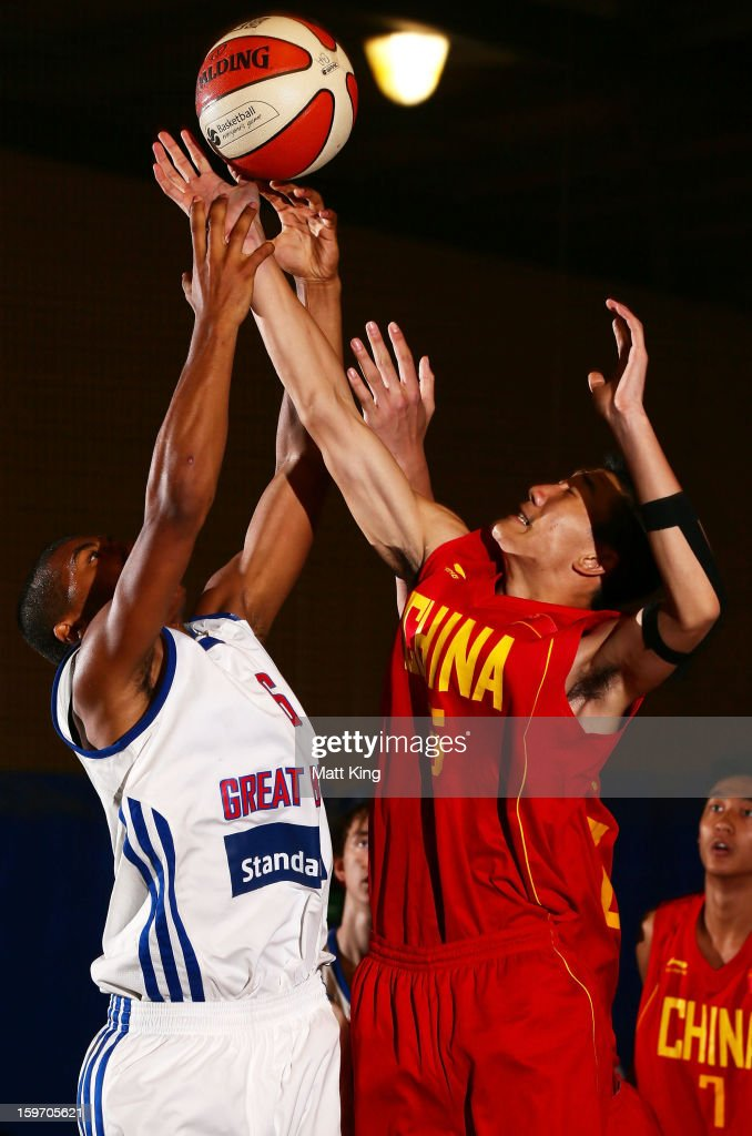Dwayne Lautier-Ogunie of Great Britain competes with Minghui Sun of China in the bronze medal playoff game during day four of the Australian Youth Olympic Festival at Sydney Boys High School on January 19, 2013 in Sydney, Australia.