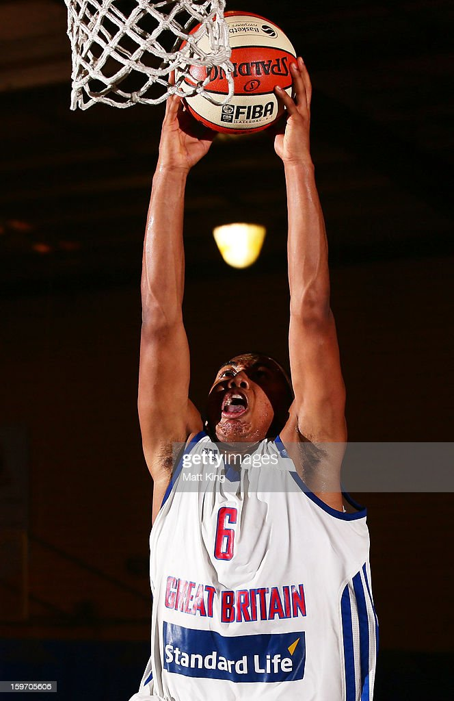 Dwayne Lautier-Ogunie of Great Britain drives to the basket in the bronze medal playoff game against China during day four of the Australian Youth Olympic Festival at Sydney Boys High School on January 19, 2013 in Sydney, Australia.