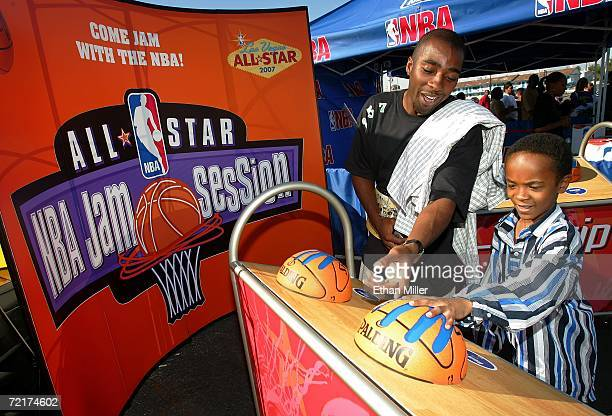 Dwayne Long and his cousin Russell Wilson both of Las Vegas compare their hand sizes to those of NBA players at the mini NBA AllStar Jam Session...