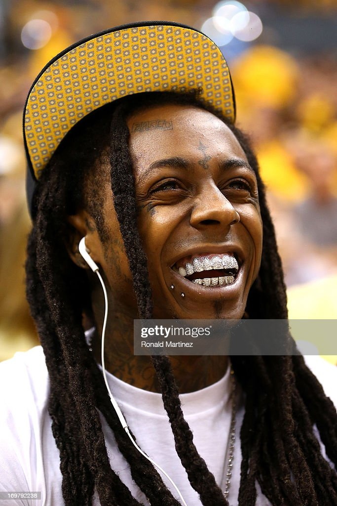 Dwayne Michael Carter Jr. known by his stage name Lil Wayne attends Game Six of the Eastern Conference Finals between the Miami Heat and the Indiana Pacers during the 2013 NBA Playoffs at Bankers Life Fieldhouse on June 1, 2013 in Indianapolis, Indiana.