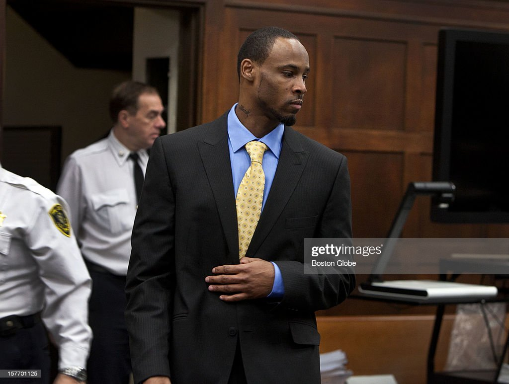 Dwayne Moore enters the courtroom to attend the closing arguments of his retrial at Suffolk Superior Court on December 4, 2012. Moore is on trial for the second time on four counts of first-degree murder.
