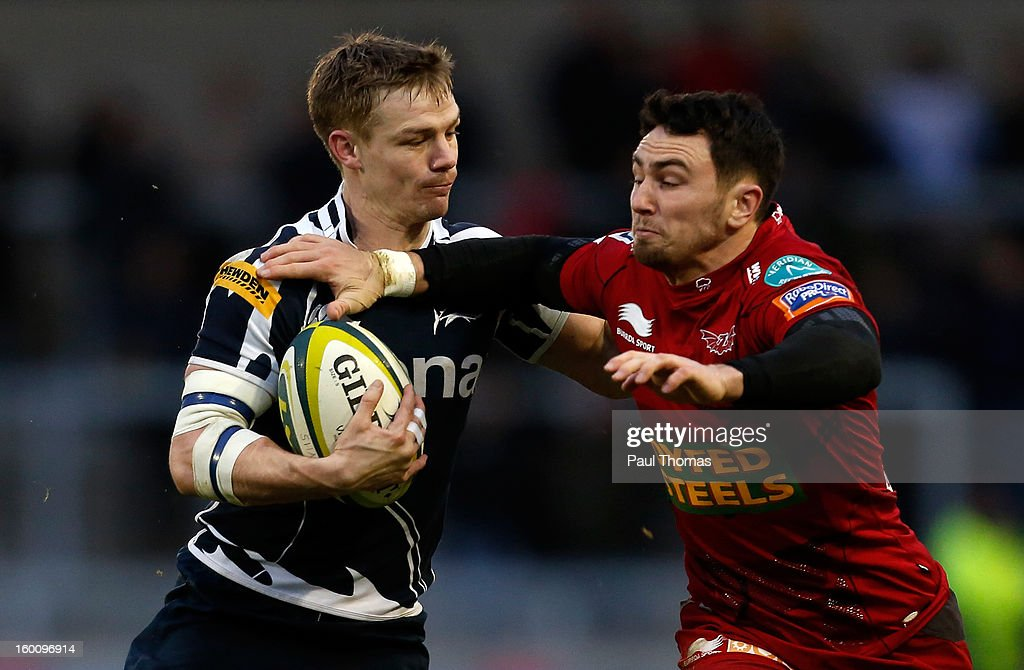 <a gi-track='captionPersonalityLinkClicked' href=/galleries/search?phrase=Dwayne+Peel&family=editorial&specificpeople=206685 ng-click='$event.stopPropagation()'>Dwayne Peel</a> (L) of Sale Sharks in action with <a gi-track='captionPersonalityLinkClicked' href=/galleries/search?phrase=Kristian+Phillips&family=editorial&specificpeople=6725918 ng-click='$event.stopPropagation()'>Kristian Phillips</a> of Scarlets during the LV= Cup match between Sale Sharks and Scarlets at Salford City Stadium on January 26, 2013 in Salford, England.