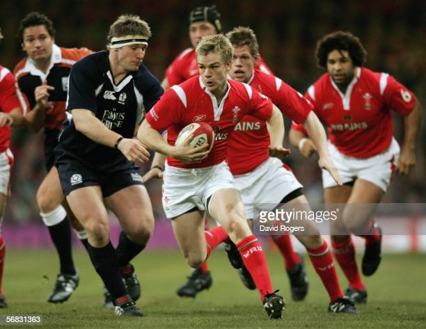 Dwayne Peel of Wales goes past Scotland's Gavin Kerr during the RBS Six Nations Championship match between Wales and Scotland at the Millennium...