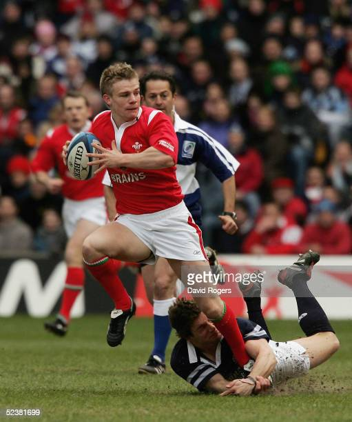 Dwayne Peel of Wales is tackled by Chris Cusiter of Scotland during the RBS Six Nations International between Scotland and Wales at Murrayfield on...