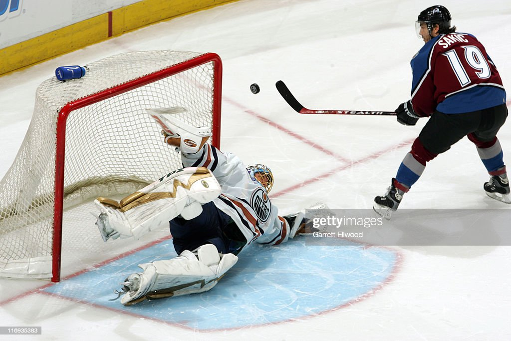 <a gi-track='captionPersonalityLinkClicked' href=/galleries/search?phrase=Dwayne+Roloson&family=editorial&specificpeople=202970 ng-click='$event.stopPropagation()'>Dwayne Roloson</a> #35 of the Edmonton Oilers stops the sudden death shot by <a gi-track='captionPersonalityLinkClicked' href=/galleries/search?phrase=Joe+Sakic&family=editorial&specificpeople=202869 ng-click='$event.stopPropagation()'>Joe Sakic</a> #19 of the Colorado Avalanche during the game on March 26, 2006 at Pepsi Center in Denver, Colorado.