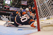 Dwayne Roloson of the New York Islanders blocks a shot by Marian Gaborik of the New York Rangers at the Nassau Coliseum on March 30 2010 in Uniondale...