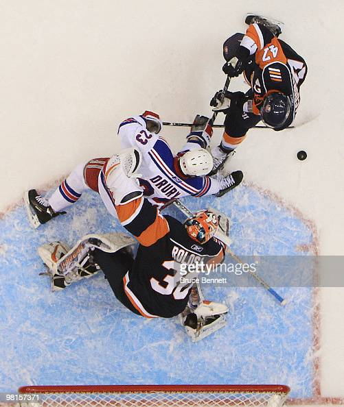 Dwayne Roloson of the New York Islanders makes the save on Chris Drury of the New York Rangers at the Nassau Coliseum on March 30 2010 in Uniondale...