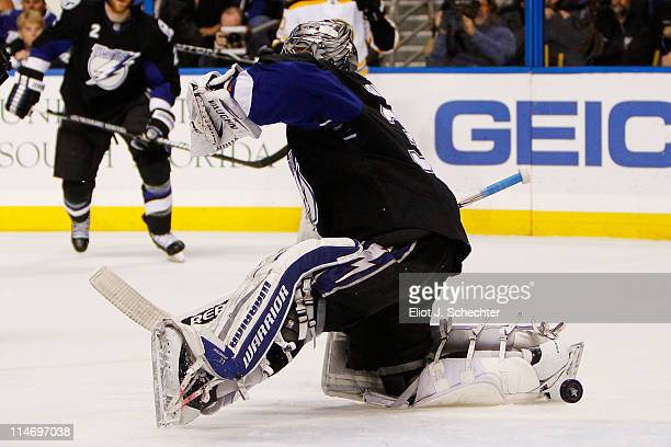 Dwayne Roloson of the Tampa Bay Lightning fails to stop a first period goal by David Krejci of the Boston Bruins in Game Six of the Eastern...