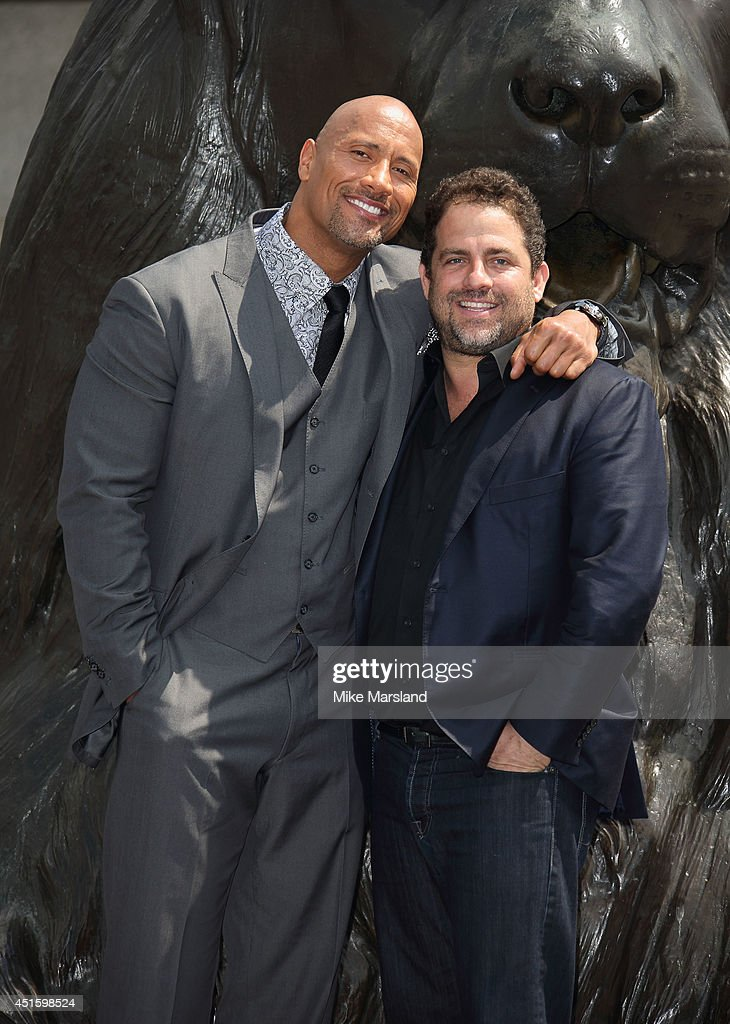 Dwayne 'The Rock' Johnson and Brett Ratner attend a photocall for 'Hercules' on July 2, 2014 in London, England.