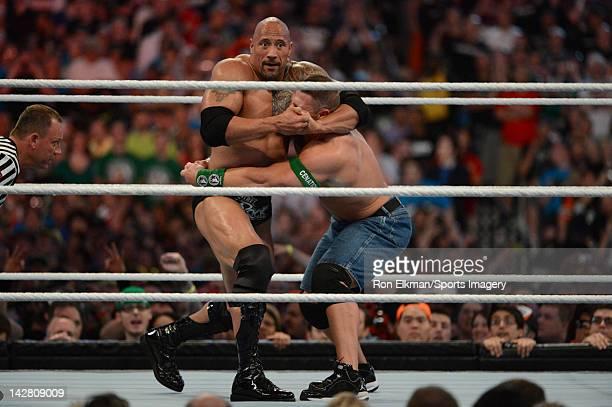 Dwayne ''The Rock'' Johnson and John Cena in action during WrestleMania XXVIII at Sun Life Stadium on April 1 2012 in Miami Gardens Florida