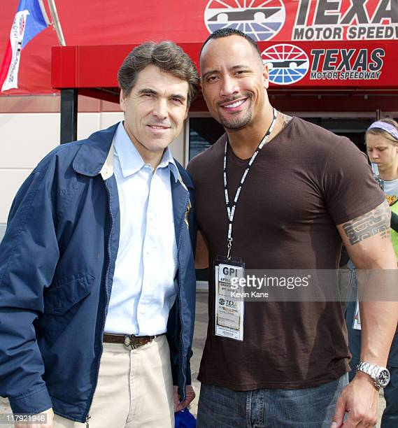 Dwayne 'The Rock' Johnson and the Governor of Texas Rick Perry prior to the start of the NASCAR Nextel Cup Samsung/Radio Shack 500 Texas Motor...