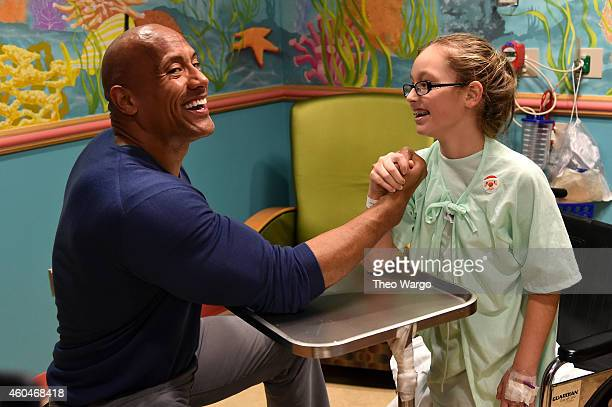 Dwayne 'The Rock' Johnson attends the Christmas in Washington 2014 Children's Hospital visit at Children's National Medical Center on December 13...