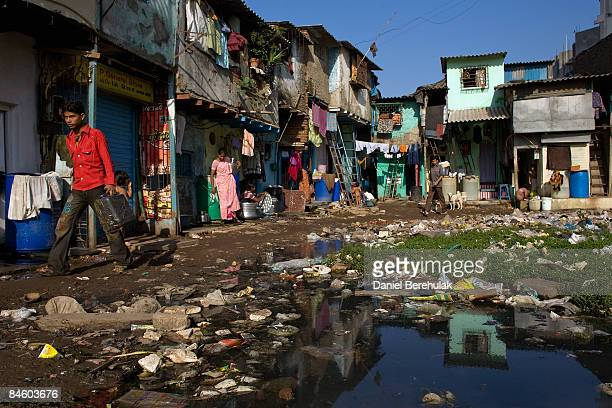 Dwellers go about their daily routine in the Dharavi slum on February 3 2009 in Mumbai India The redevelopment of asia's largest slum the Dharavi...