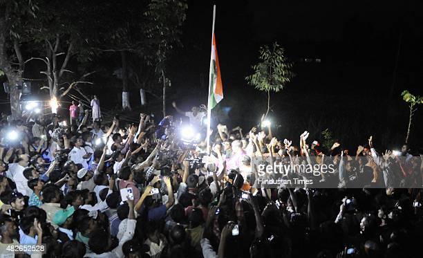 Dwellers hoist Indian National Flag at Madhya Mashaldanga enclave Cooch Behar during the zero hour celebration on August 1 2015 in Cooch Behar India...